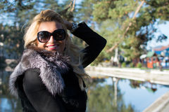 Young sexy russian girl in a park with long blond hair. Young sexy attractive woman with long blonde hair in a park Stock Images