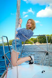 Young sexy sailor girl. A girl on a yacht with a rope Royalty Free Stock Images