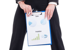 Young and sexy sales woman showing financial charts and graphs Stock Images