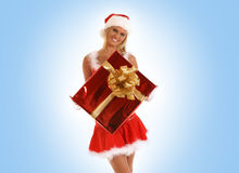 A young and sexy Santa with a Christmas gift Royalty Free Stock Photos