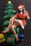 Young Santa Claus Girl on black background Royalty Free Stock Photography