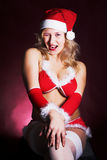 Young sexy Santa Girl. In red hat Stock Photography