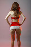 Young and sexy santa girl with a big ass. Stock Image