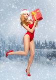 Young and Santa girl in a red Christmas swimsuit Stock Photo