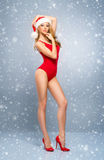 Young and sexy Santa girl in a red Christmas swimsuit Stock Photo