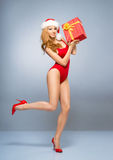 Young and sexy Santa girl in the red swimsuit Stock Photography
