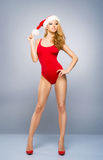 Young and sexy Santa girl in a red swimsuit Royalty Free Stock Image