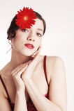 Young Sexy sensual woman with red flower Stock Photo