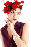 Young sensual woman with red flowers Stock Image