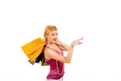 Young sexy shopping girl with colourfull bags Stock Image