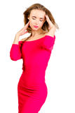 Young sexy slim pretty woman dressing red dress posing isolated Stock Photos