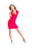 Young sexy slim pretty woman dressing red dress posing. On white Stock Photos
