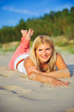 Young sexy summer girl relaxing on the beach Royalty Free Stock Images