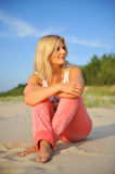 Young summer woman on evening beach Stock Photography