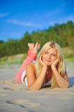 Young sexy summer woman on evening beach. In pink jeans dreamin. eyes closed Stock Photography