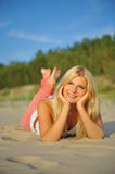 Young sexy summer woman relaxing on the beach Stock Photos