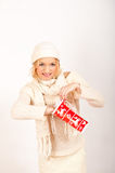 Young winter woman with red christmas gift Royalty Free Stock Images
