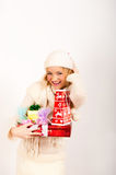 Young sexy winter woman with red christmas gift Royalty Free Stock Photos