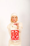 Young winter woman with red present Stock Images