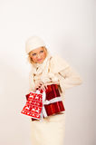 Young winter woman with red present Stock Image