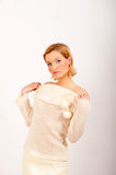 Young winter woman in white knit clothes Stock Photography