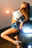 Young sexy woman. With car Stock Photography