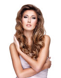Young sexy woman with beautiful long wavy hair and makeup Royalty Free Stock Photos