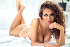 Young sexy woman in bed Stock Photography