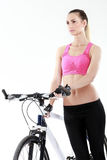 Young sexy woman on a bicykle Royalty Free Stock Photo