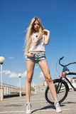 Young sexy woman with bike outdoors Royalty Free Stock Images