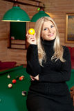 Young sexy woman with billiard balls Stock Photo