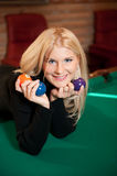 Young sexy woman with billiard balls Stock Images