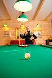 Young sexy woman with billiard balls Royalty Free Stock Photo