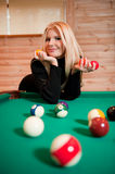 Young sexy woman with billiard balls Stock Image