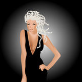 Young sexy woman in black dress with silver pearls Royalty Free Stock Photography