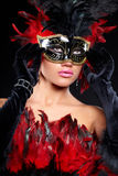 Young sexy woman in black  party half mask. Young sexy woman in black party half mask. may be use for fashion makeup concept Stock Photo