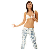 Young sexy woman in bra and jeans Royalty Free Stock Image