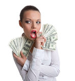 Young sexy woman with bundle of money wipe a mouth Stock Photos
