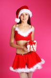 A young and sexy woman in a Christmas dress Stock Images