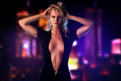 Young sexy woman. On city background Stock Photos