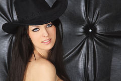 Young woman in cowboy hat. Over dark Royalty Free Stock Photos