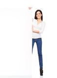 Young woman in denim jeans holding a blank banner Stock Photo