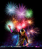 Young sexy woman dj playing music, firework on backround Stock Images