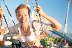 Girl with dirndl does oktoberfest wiesn in munic. Young woman is doing oktoberfest in munic bavaria in the spring summer autumn folk festival. she is wearing a royalty free stock images