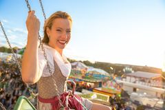 Girl with dirndl does oktoberfest wiesn in munic. Young woman is doing oktoberfest in munic bavaria in the spring summer autumn folk festival. she is wearing a royalty free stock image