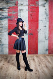 Young sexy woman dressed in leather and hat Royalty Free Stock Photography