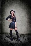 Young sexy woman dressed in leather and hat Stock Images