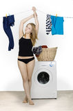 Young sexy woman dries clothes Stock Photos