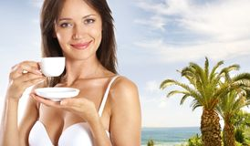 A young and sexy woman is drinking coffee Royalty Free Stock Photos