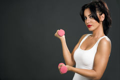 Young  sexy woman  with dumbbells Royalty Free Stock Images
